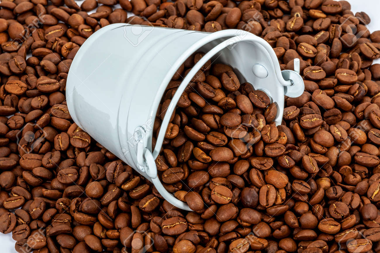 white bucket in lot of coffee beans - 162319071