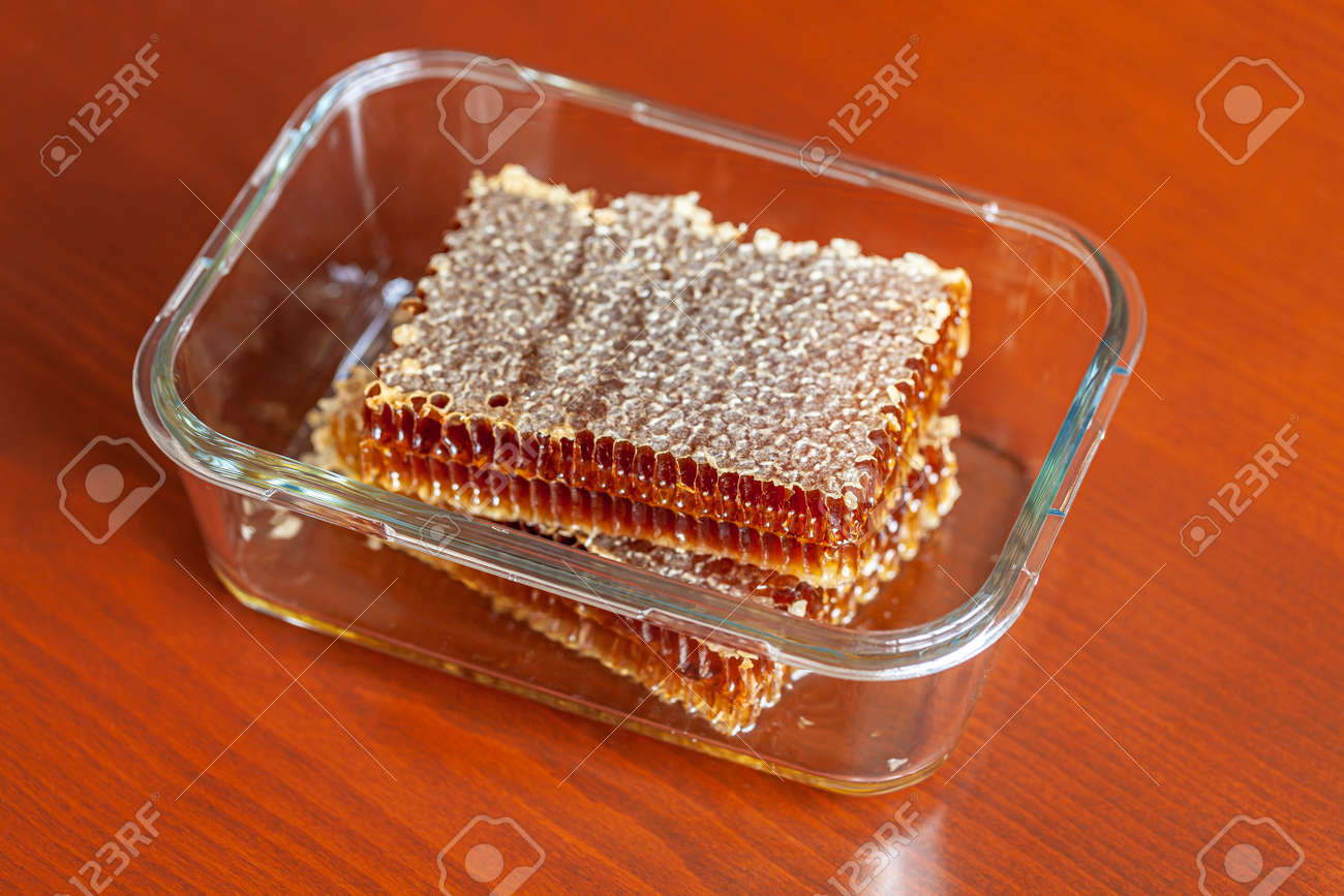 Honeycomb and honey drops closeup - 163881243