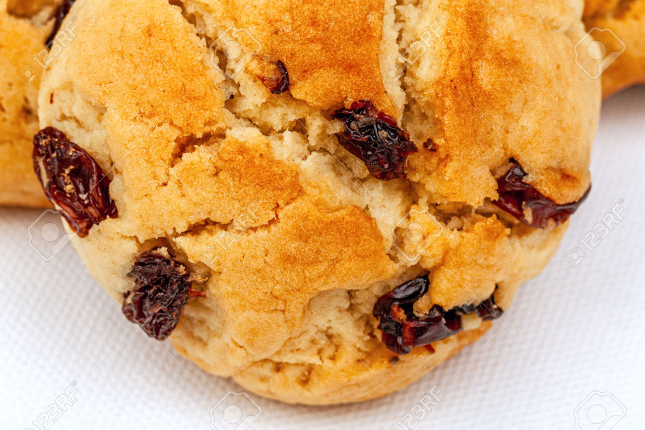Plenty of raisin cookies on a white background, detailed view - 163881248