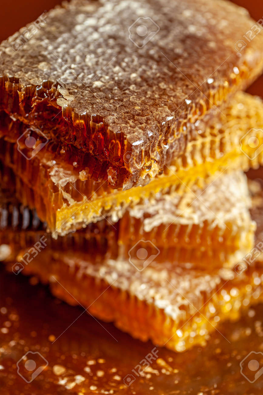 stacked honeycomb pieces dripping close-up - 163881249
