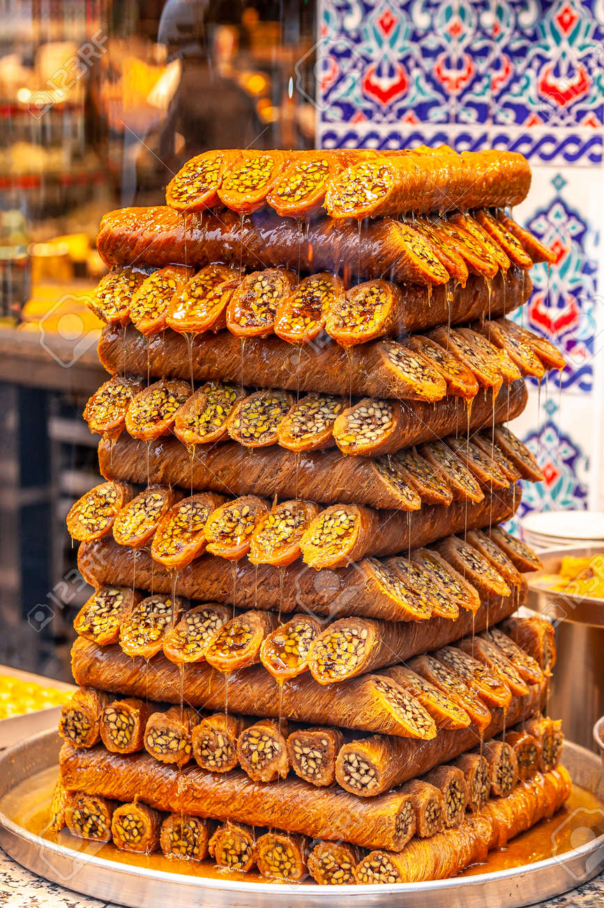 """Traditional Turkish sweet called """"Burma Kadayif"""" made with dough wrapped around a pistachios. - 165921215"""