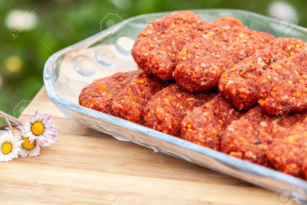 meatballs plate ready for grilling in picnic - 173222561
