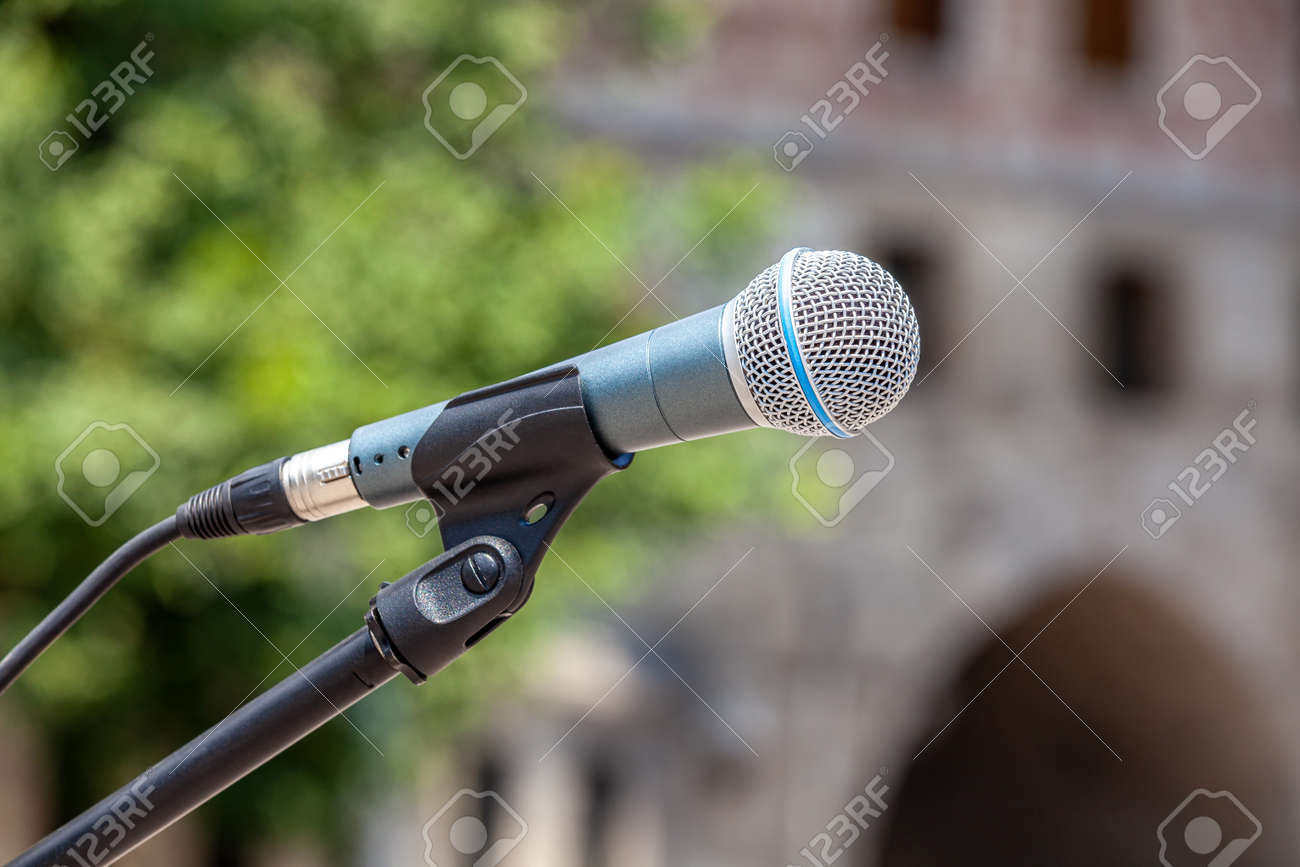 Microphone on abstract blurred meeting area - 173222564