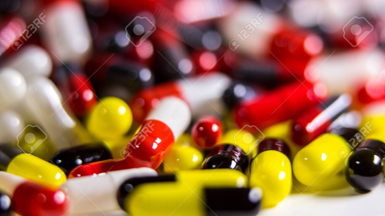 Close up of many different pills and tablets medicine isolated on white background. Prescription drugs. A lot of medication, painkillers and drug abuse concept. - 125072333