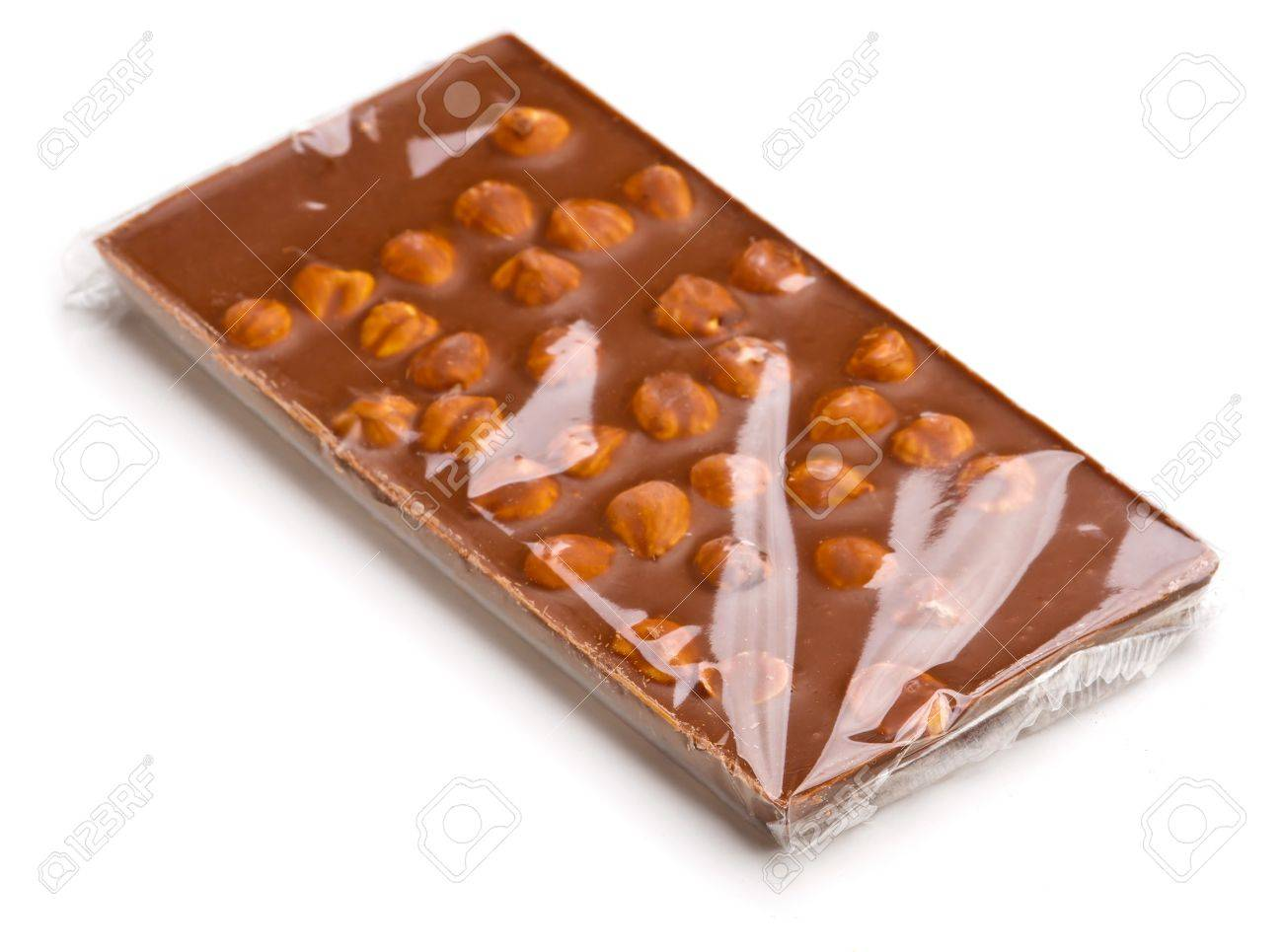 Chocolate With Nuts Wrapped In Transparent Foil Stock Photo ...