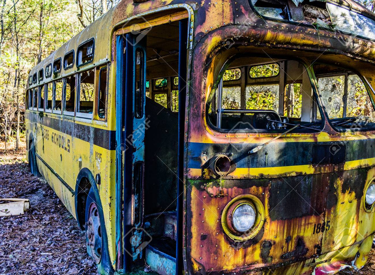 Rusty, Old, Junked Car In The Woods Stock Photo, Picture And Royalty ...