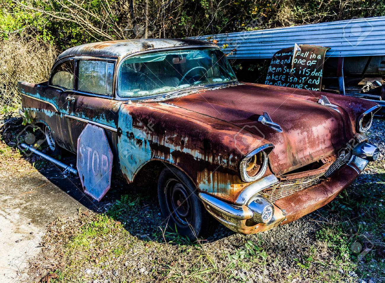 Rusty, Old, Junked Car In The Woods Stock Photo, Picture And ...