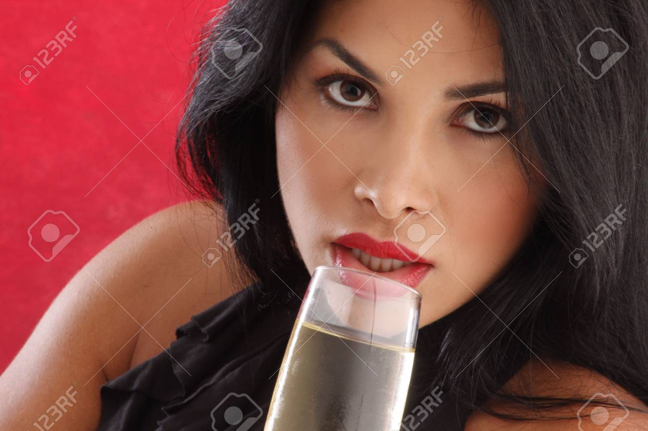 Cute brunette drinking cold white wine Stock Photo - 5036963