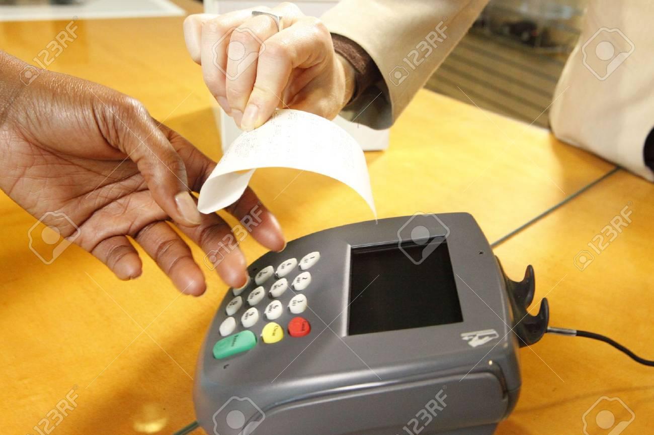 Getting a receipt through a merchant's terminal Stock Photo - 6543232