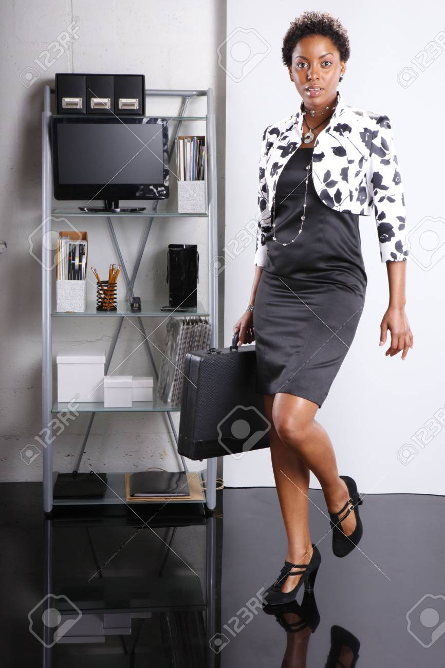 Cute executive walks in Stock Photo - 6593943