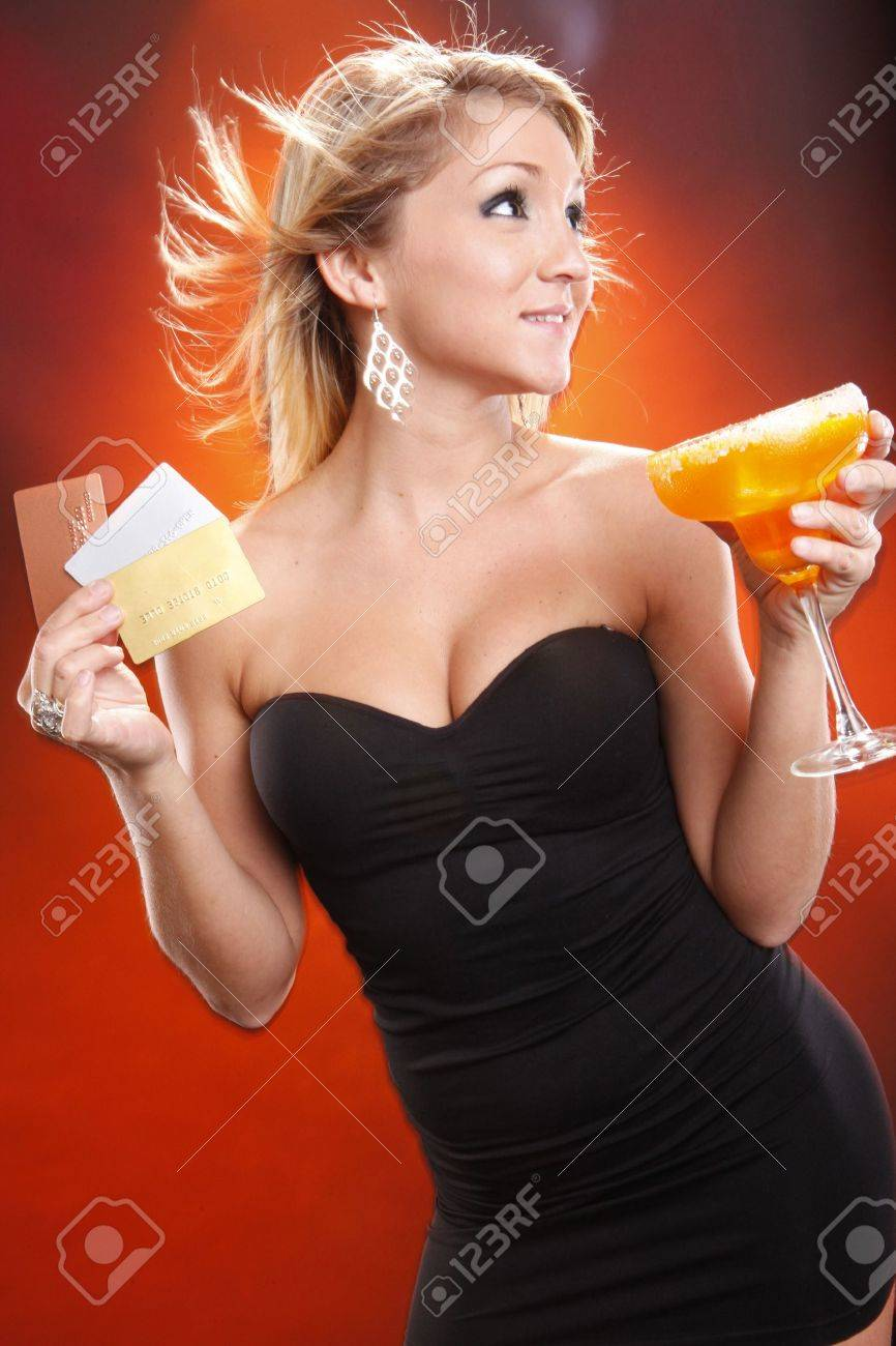 Cute blond pays for her mango margarita cocktail with plastic Stock Photo - 7538426