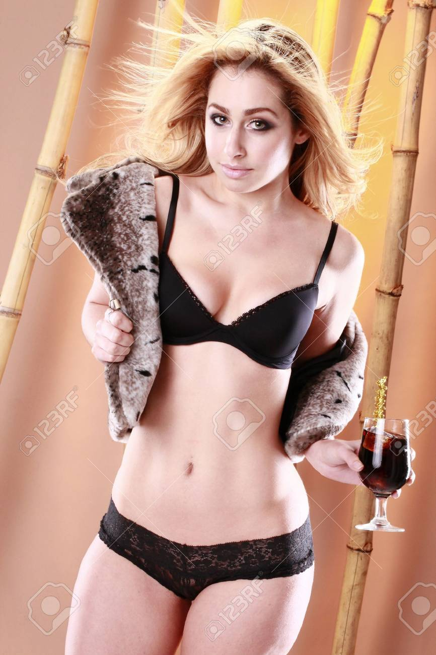 Young blond and cocktail on tropical set Stock Photo - 8706144
