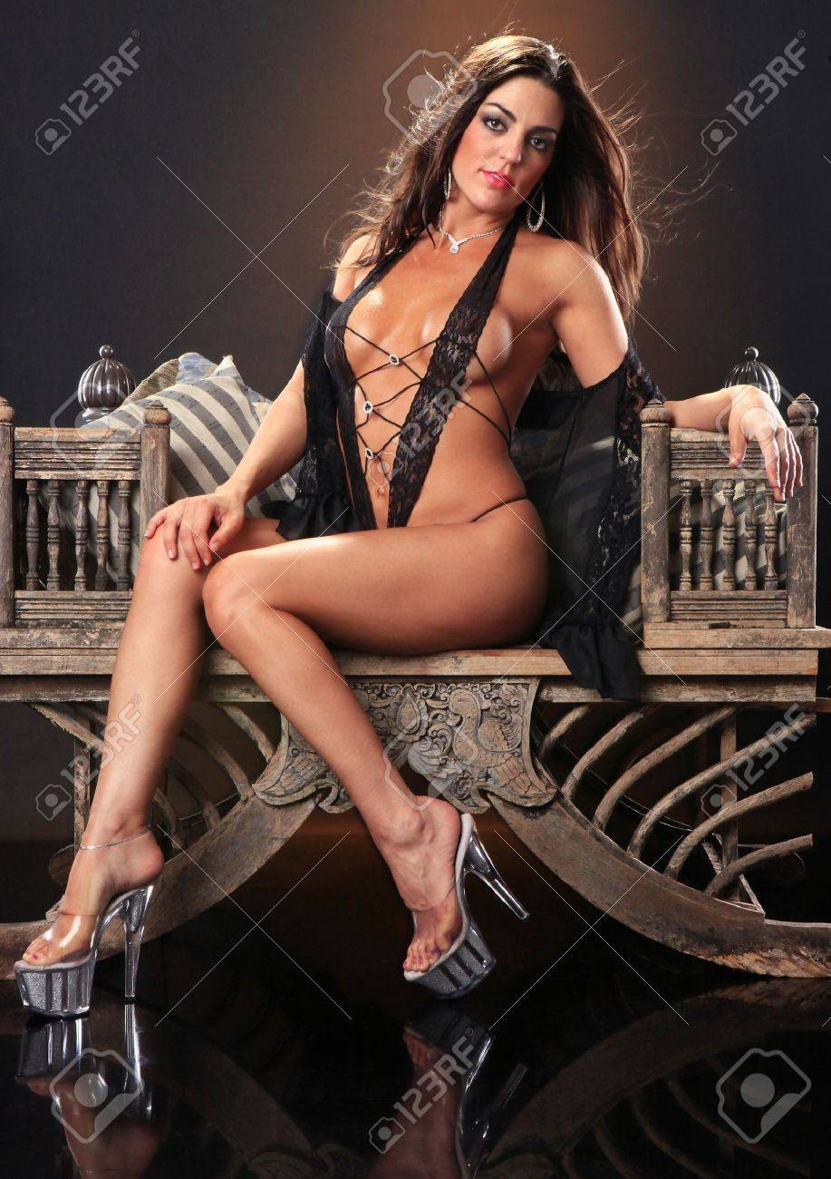 Sexy brunette on a vintage asian chair Stock Photo - 8856288