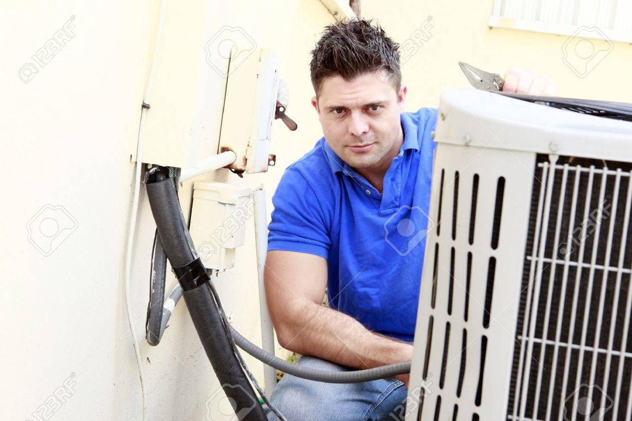 Technician Inspects An AC Unit Stock Photo, Picture And Royalty ...