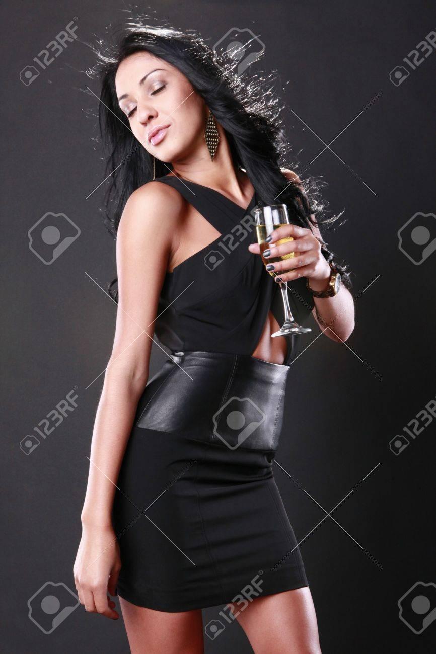 Cute brunette celebrates in evening attire Stock Photo - 9497790