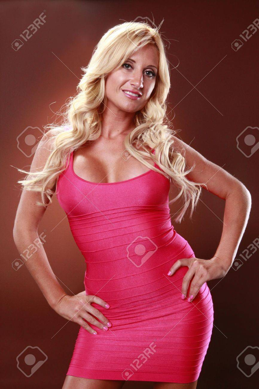 Cute European blond in tight magenta dress Stock Photo - 9838125