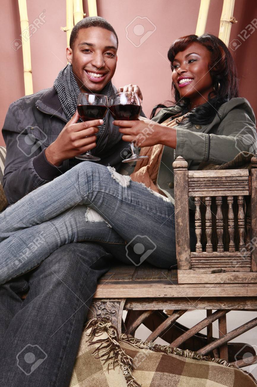 Young couple enjoys red wine at the bamboo foyer Stock Photo - 11056747