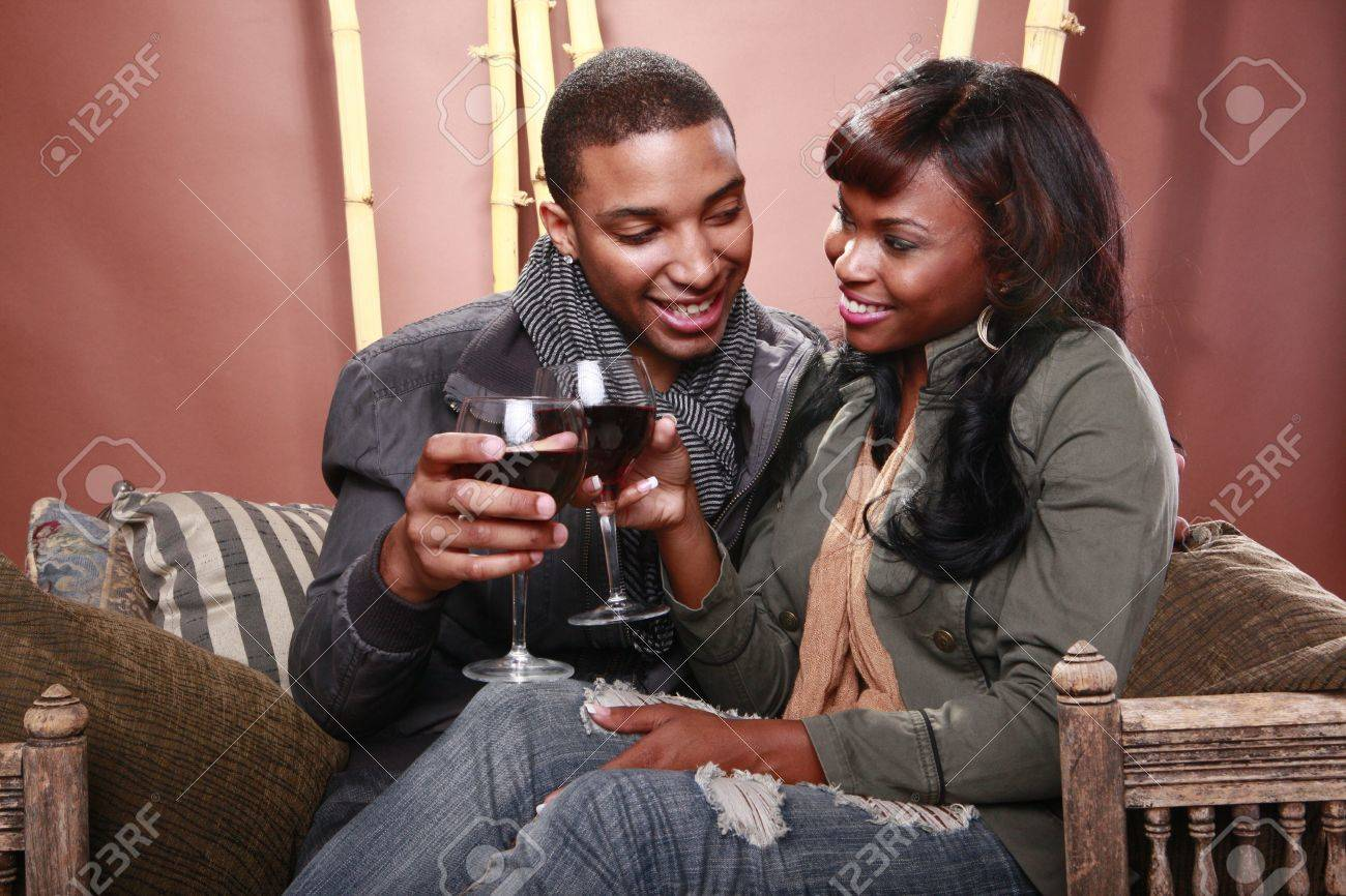 Young couple enjoys red wine at the bamboo foyer Stock Photo - 11056736