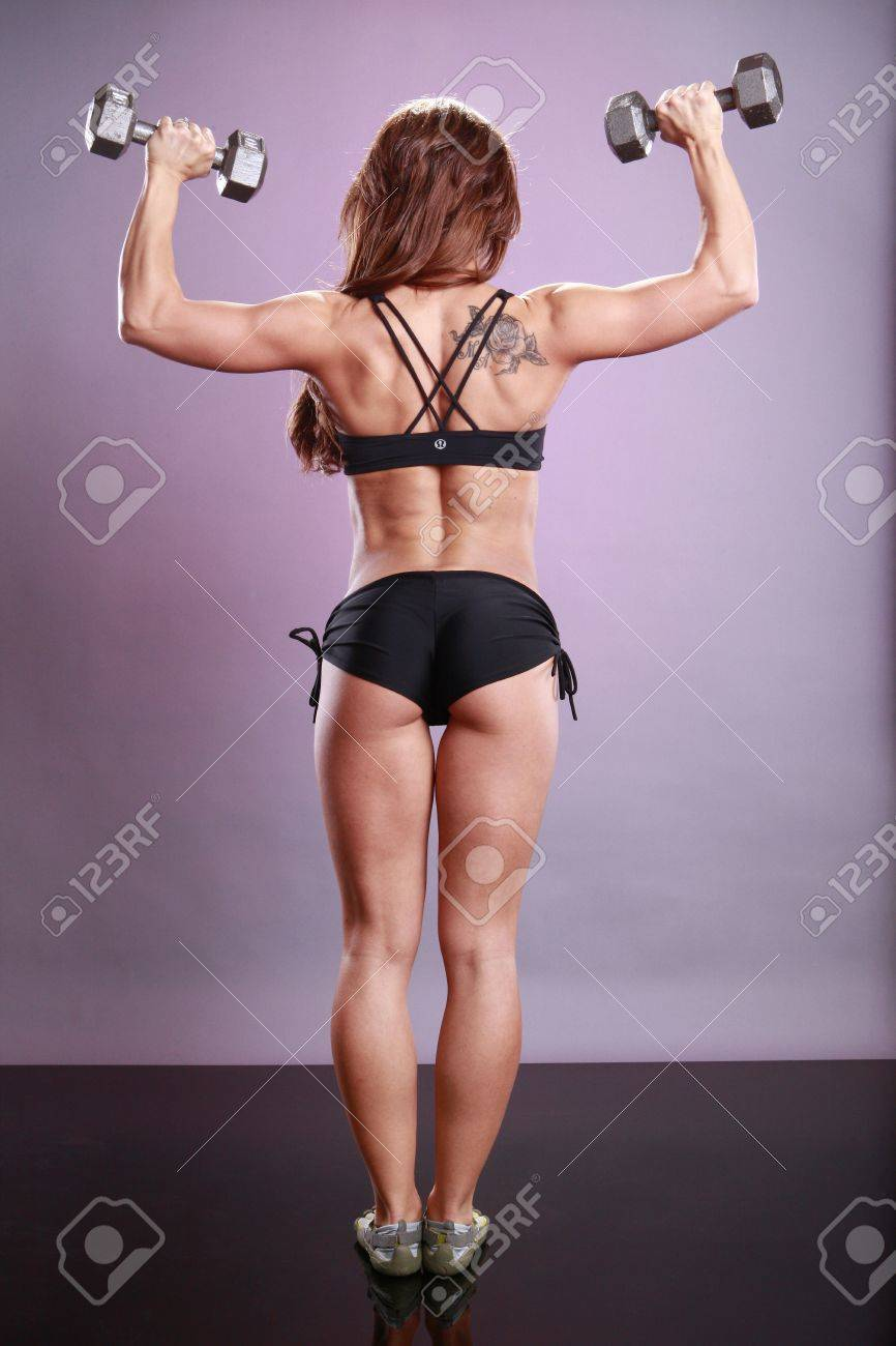 Fitness model's dumbbell routine Stock Photo - 11553033
