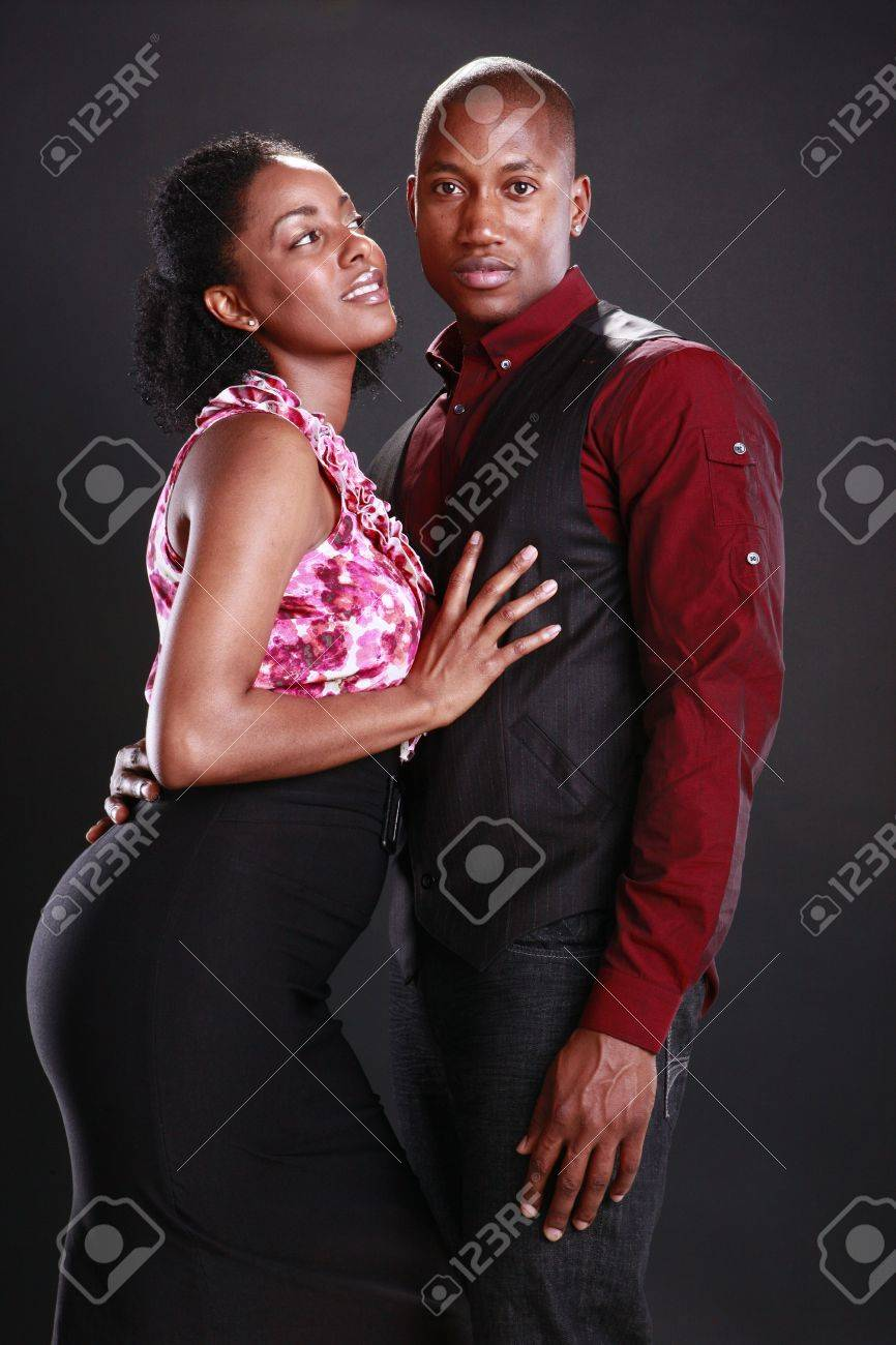 Young african american couple on black Stock Photo - 11553119