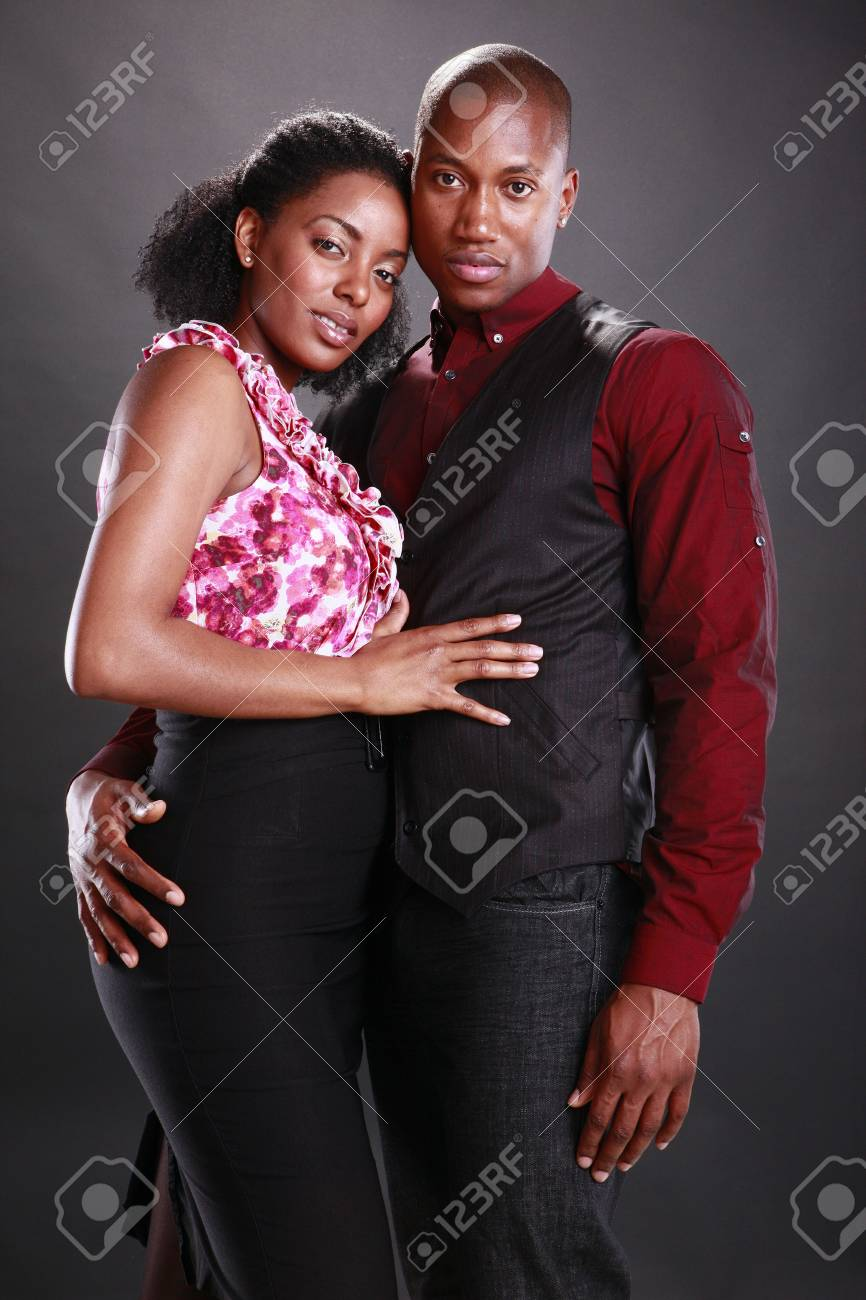 Young african american couple on black Stock Photo - 11553064