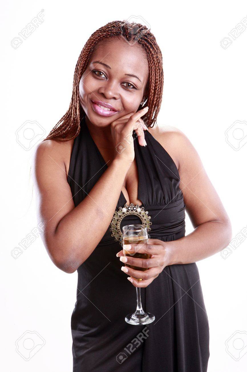 Caribbean young woman and a Champagne flute Stock Photo - 11924637