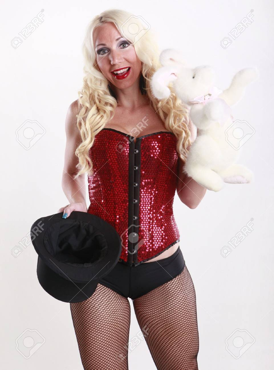 Cute magician and her bunny act Stock Photo - 17084715