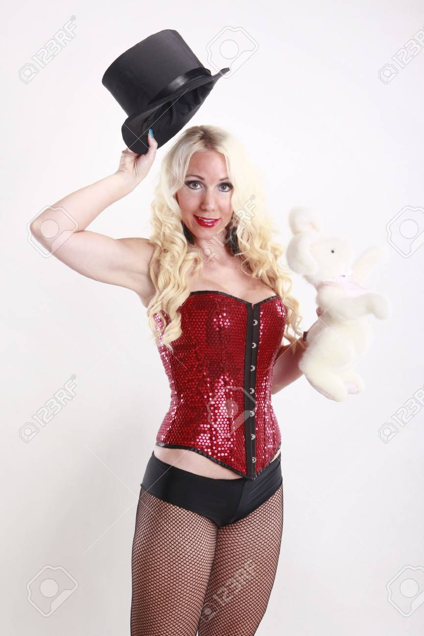 Cute magician and her bunny act Stock Photo - 17084445