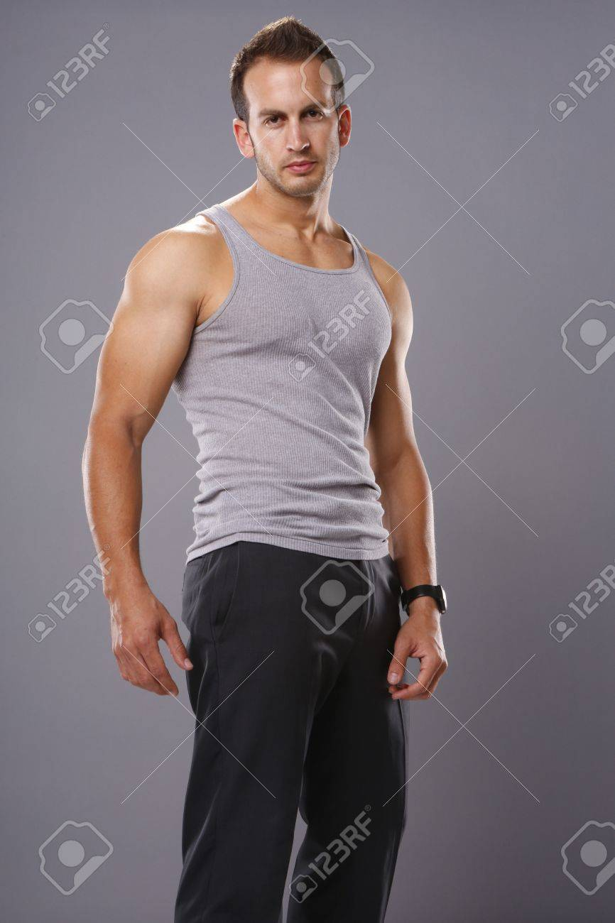 7db5196d1f530 Athletic young man in tank top Stock Photo - 19334883