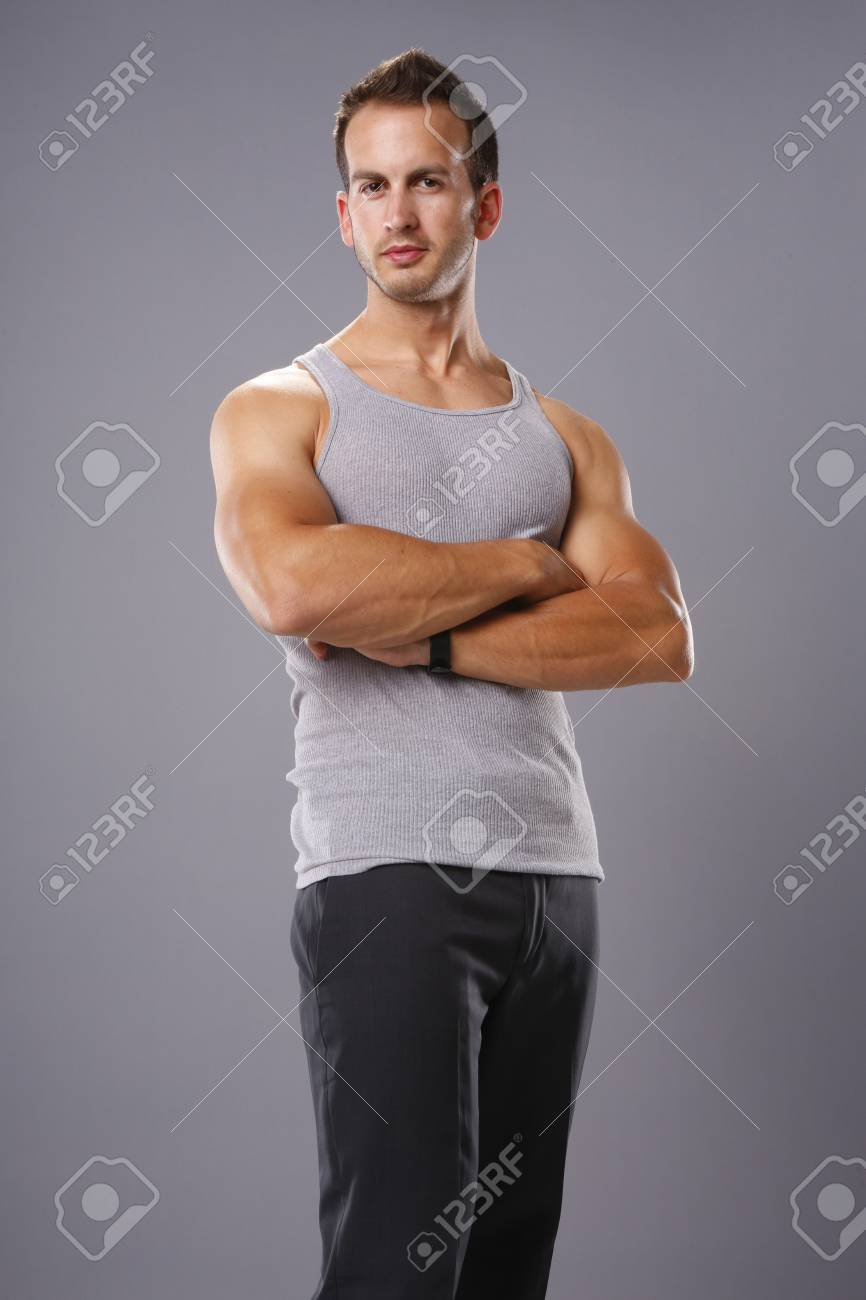 df5fadf939b10 Athletic young man in tank top Stock Photo - 19334886