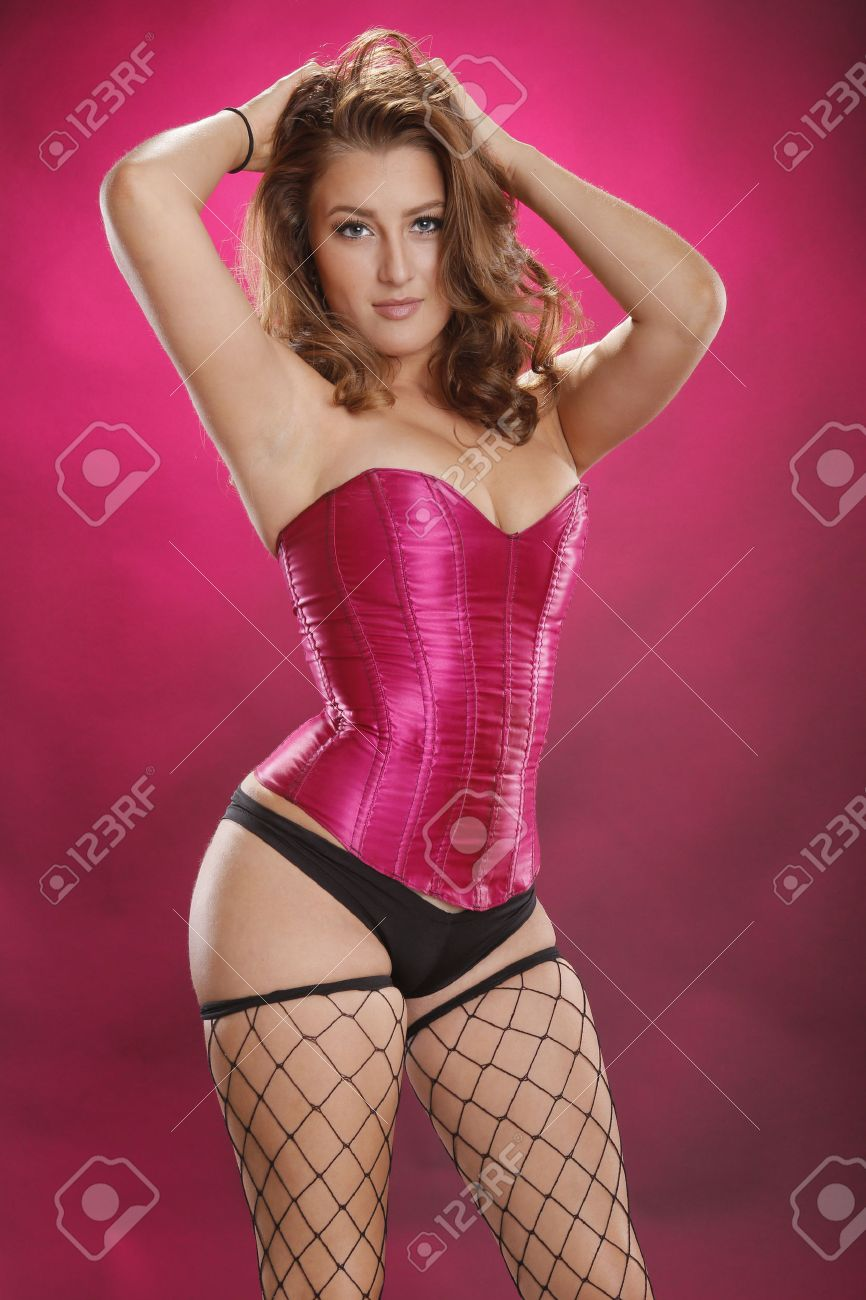 Gorgeous Red-hair In Sexy Fishnet Stockings On Magenta Stock Photo ...