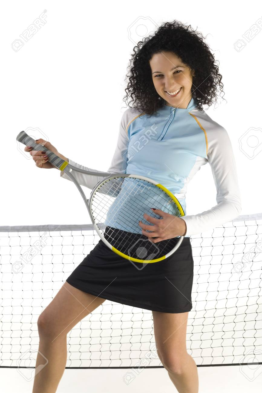 Young woman holding tennis racket. Looking at camera. White background, front view. Stock Photo - 2605958