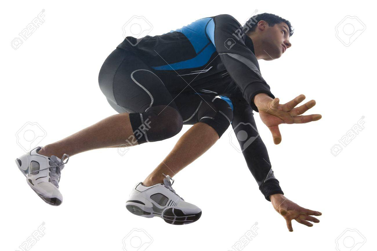 Young runner, preparing to race. Squatting and looking at something. Low angle view Stock Photo - 2605904
