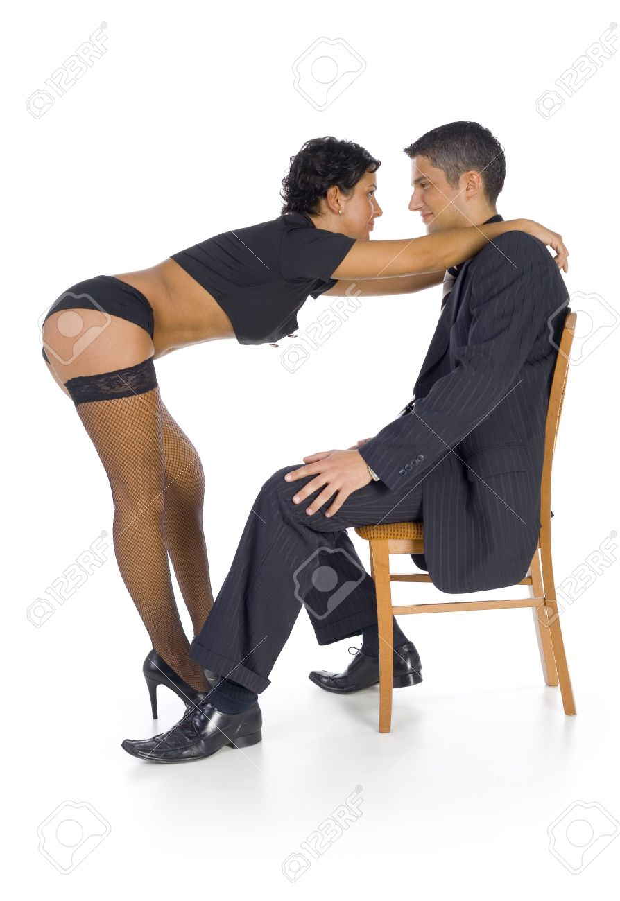 Man sitting in chair side - Stripteaser Standing In Front Of Businessman Woman Is Holding Man S Shoulders The Man Is