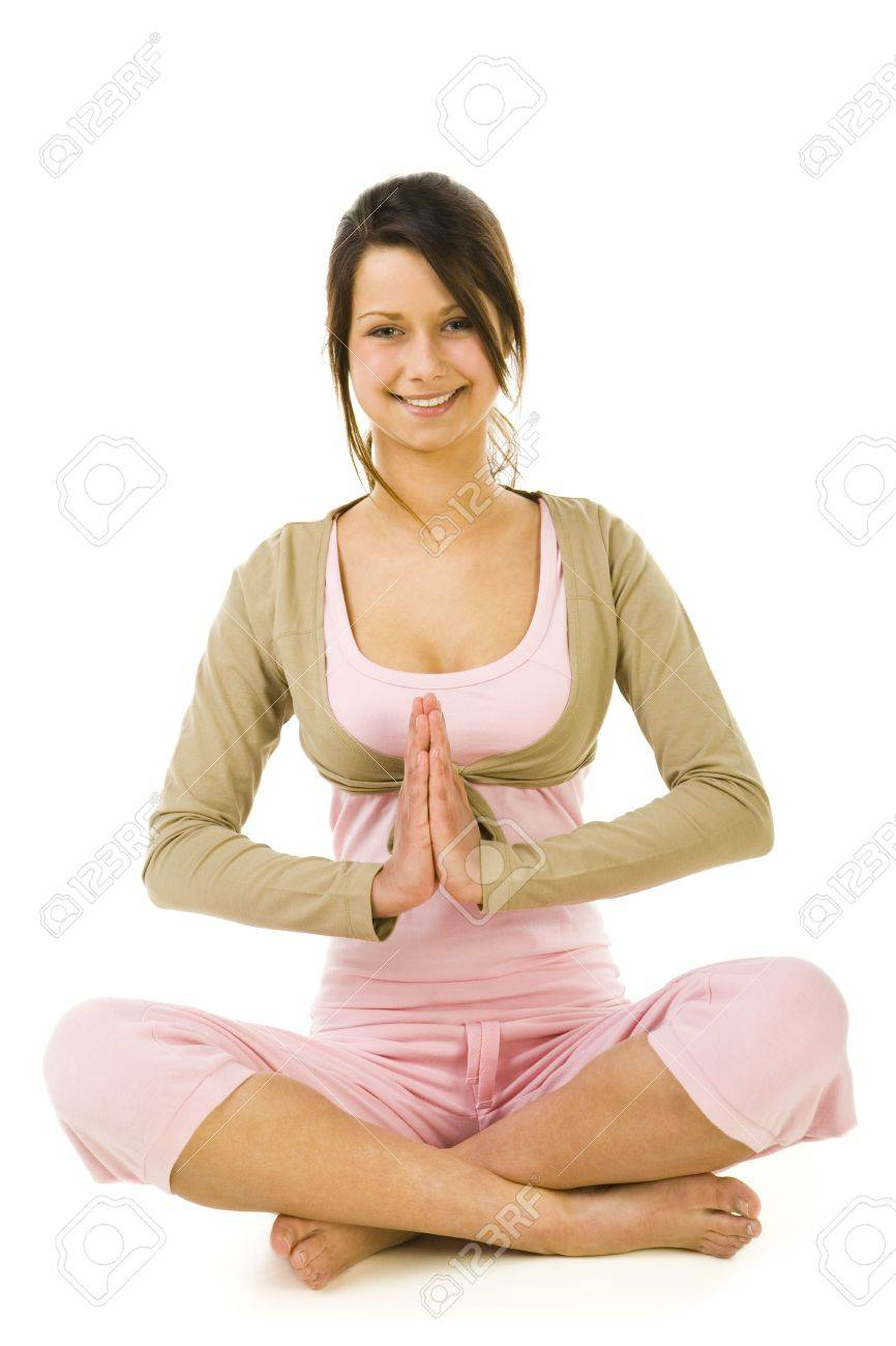 Young woman sitting cross-legged during exercises of yoga. Looking at camera and smiling. Whole body. Front view. White background. Stock Photo - 2852438