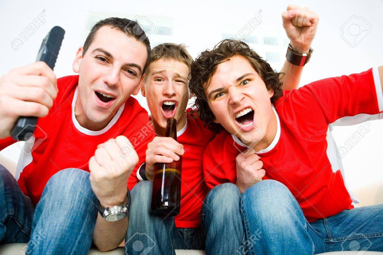 Three happy men sitting on couch and watching sport on TV. Stock Photo - 3803696