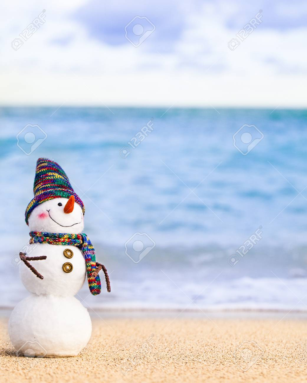 Smiling Snowman On The Sea Beach Holiday Concept Can Be Used