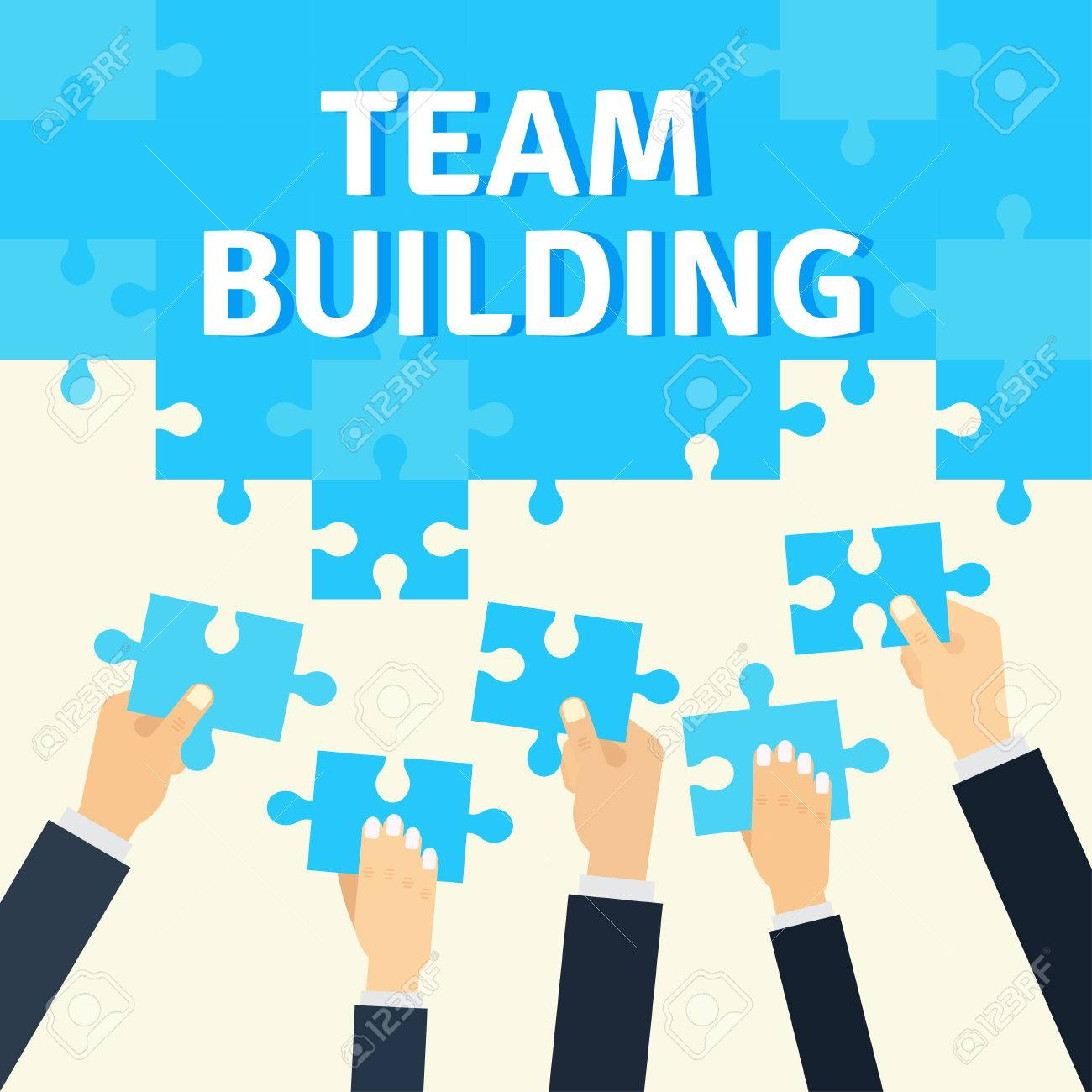 employees holding and connecting puzzle pieces together corporate