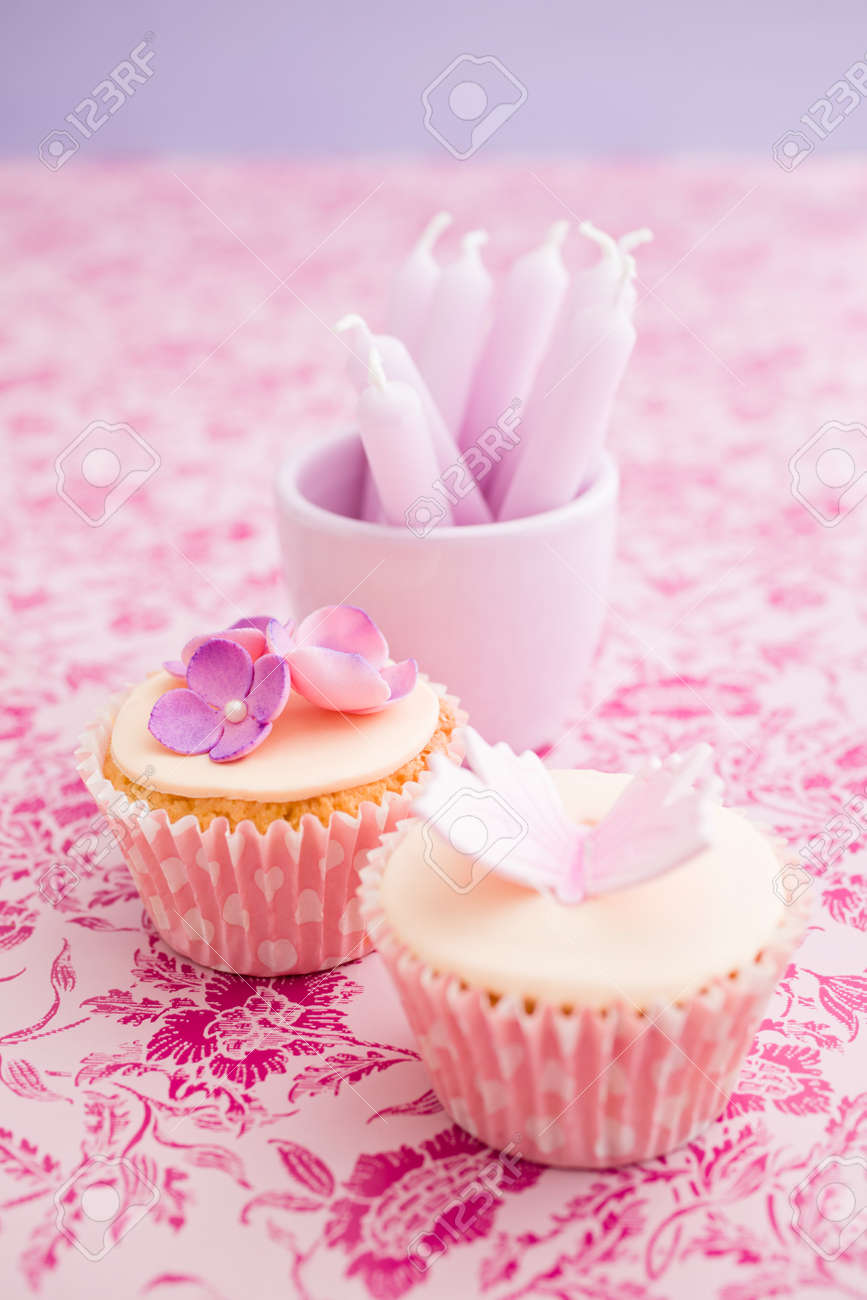Cupcakes Decorated With Pink Sugar Flowers And Birthday Candles Stock Photo