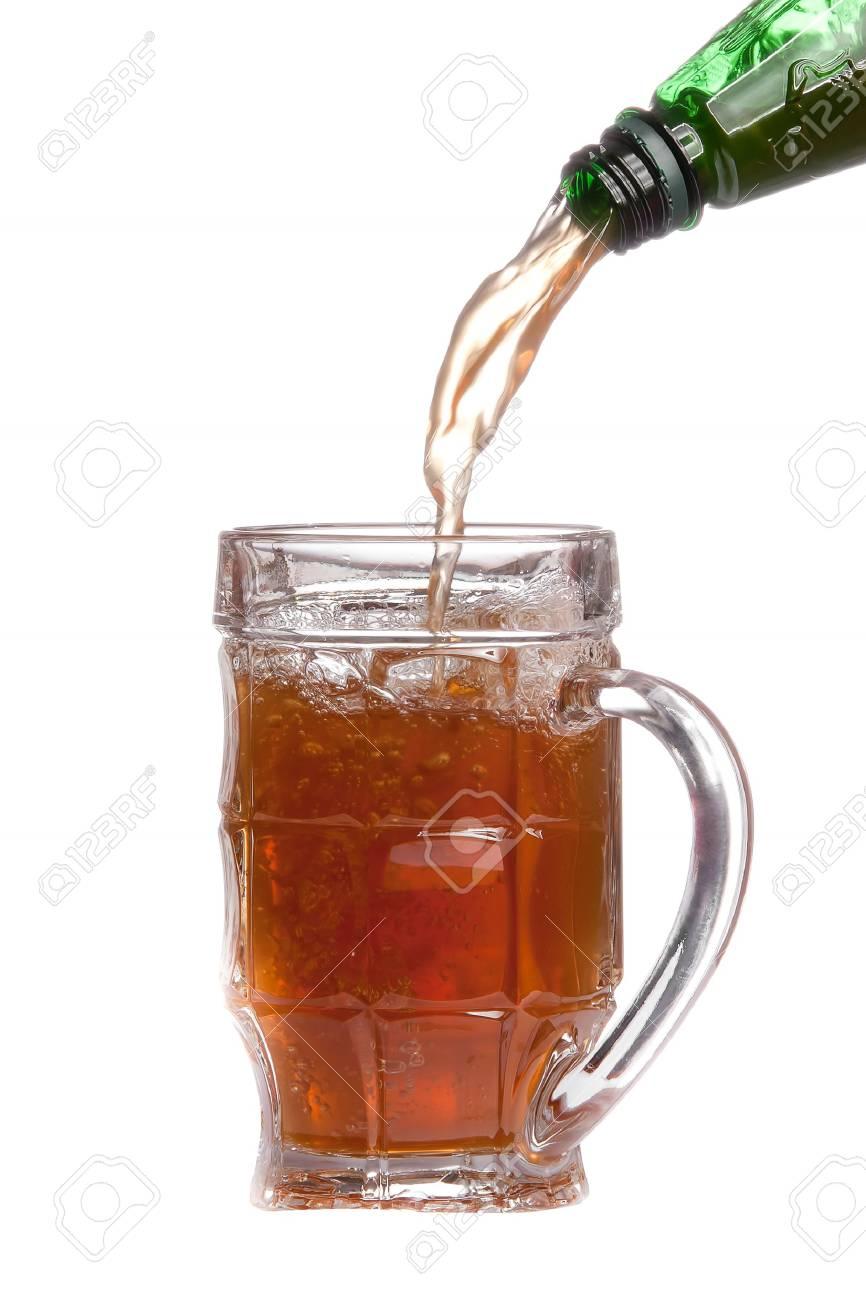 mug full of beer and green bottle isolated on white background Stock Photo - 7142081