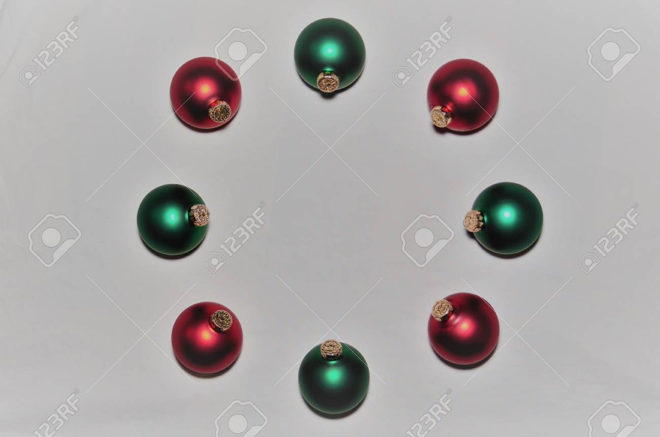 Circle Of Red And Green Christmas Ornaments Border On White Background
