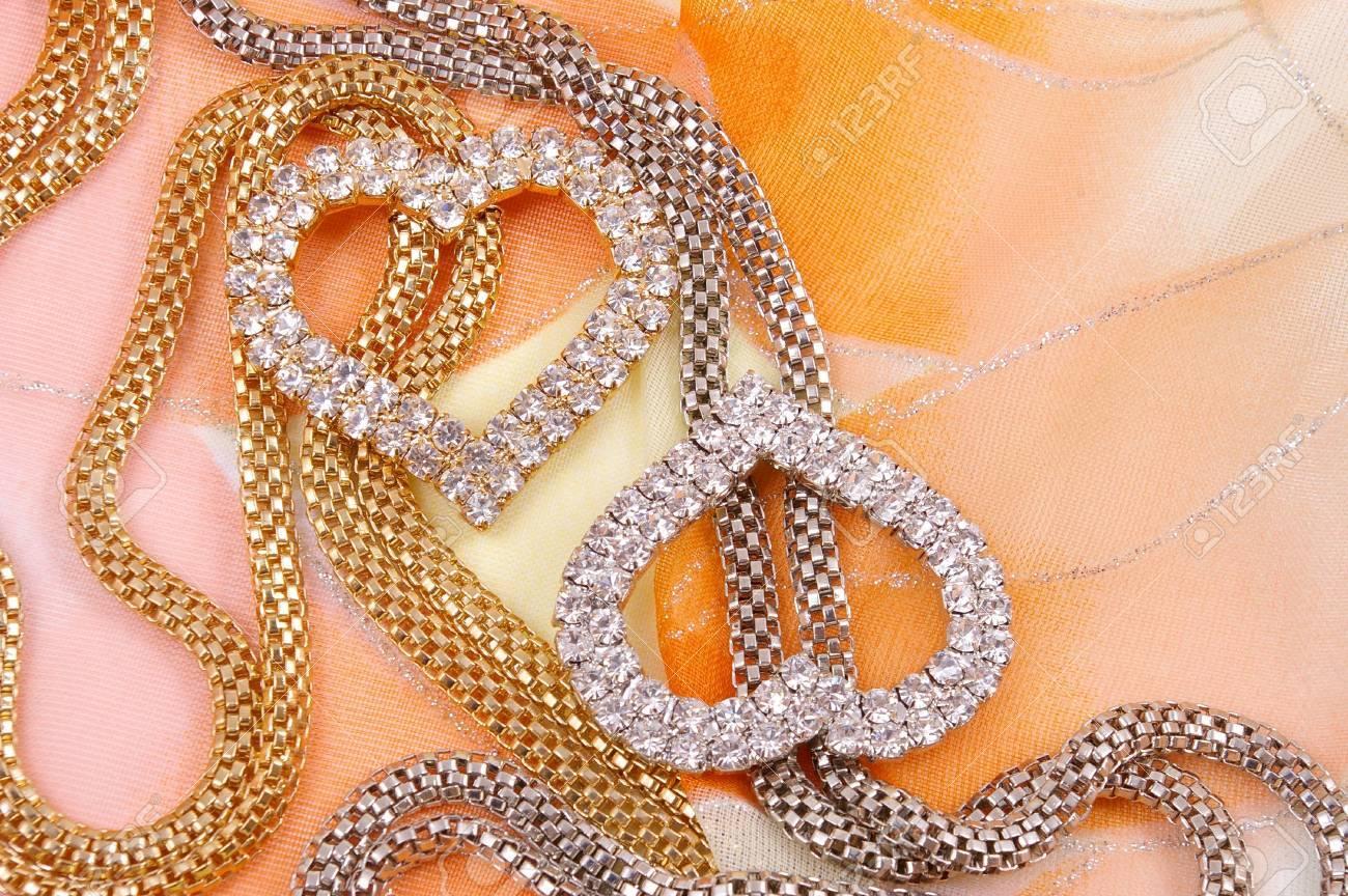 Jewelry with heart on background silk fabrics Stock Photo - 4548578