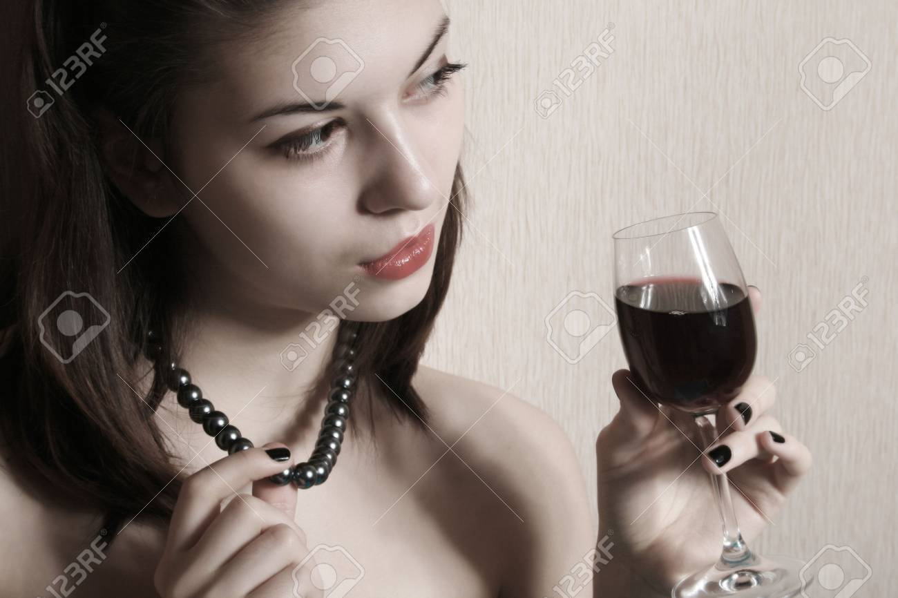 Portrait of the girl with a glass of red wine. Stock Photo - 5362699