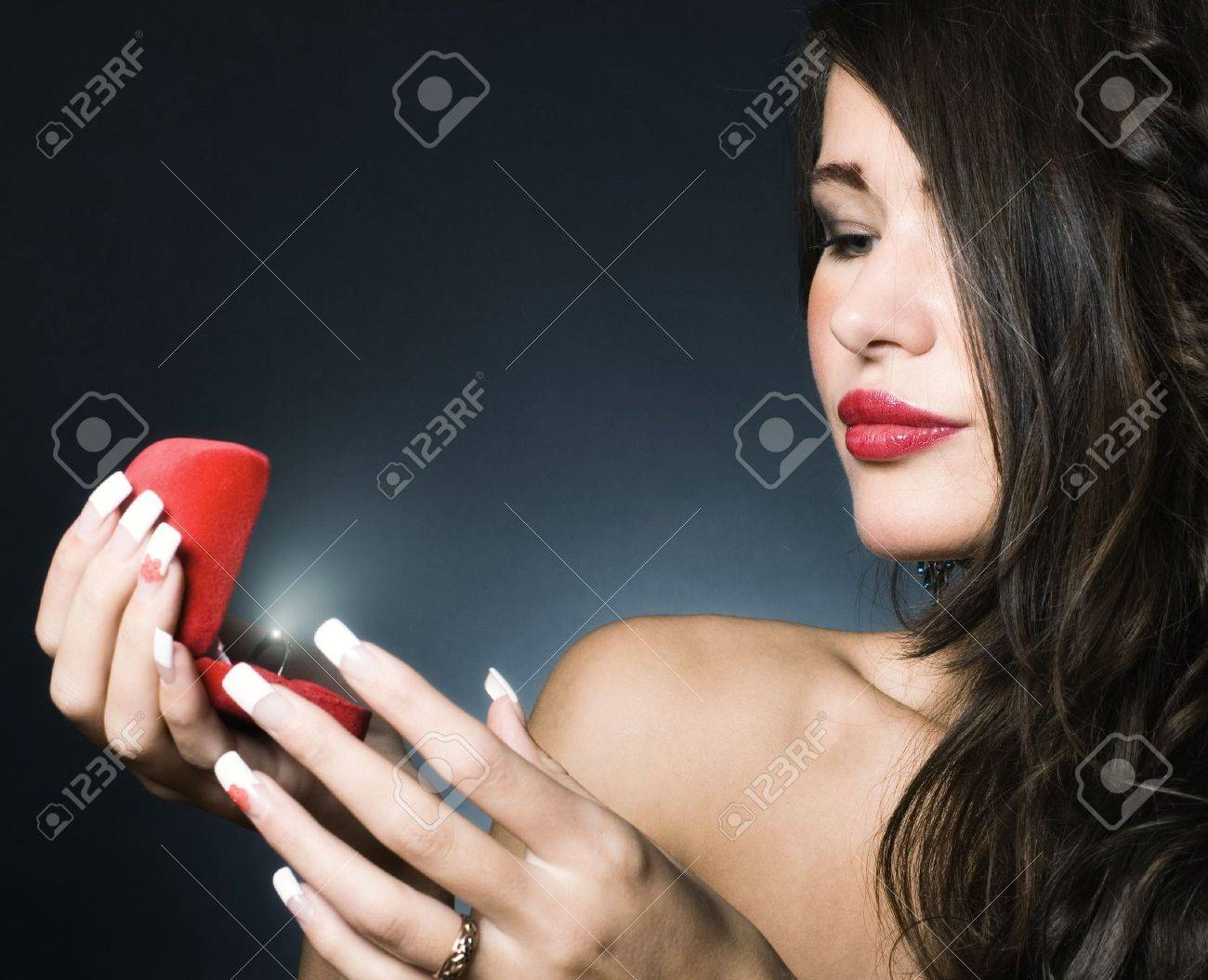 Jewel in the open case and admired woman. Stock Photo - 10936638