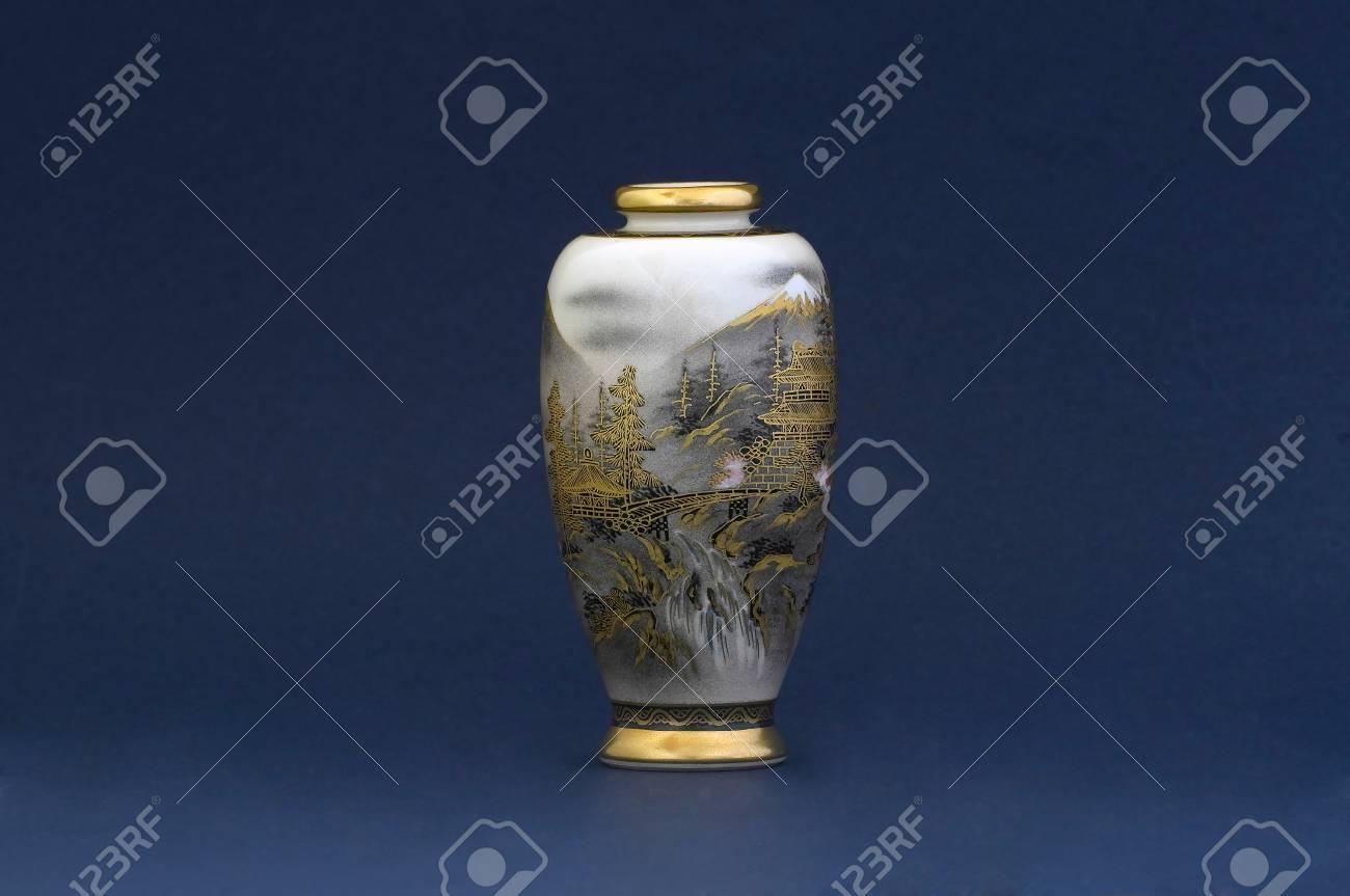 A japanese vase on blue background - 32558776
