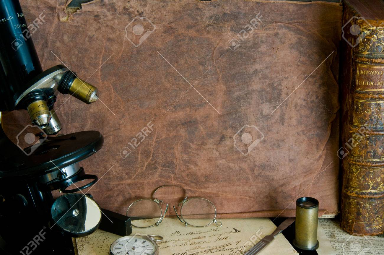 Background with microscope, pince nez, a silver watch and old books - 32738360