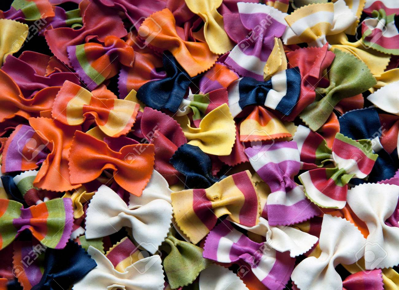 Background of multicolor italian bowtie farfalle pasta - 34321591
