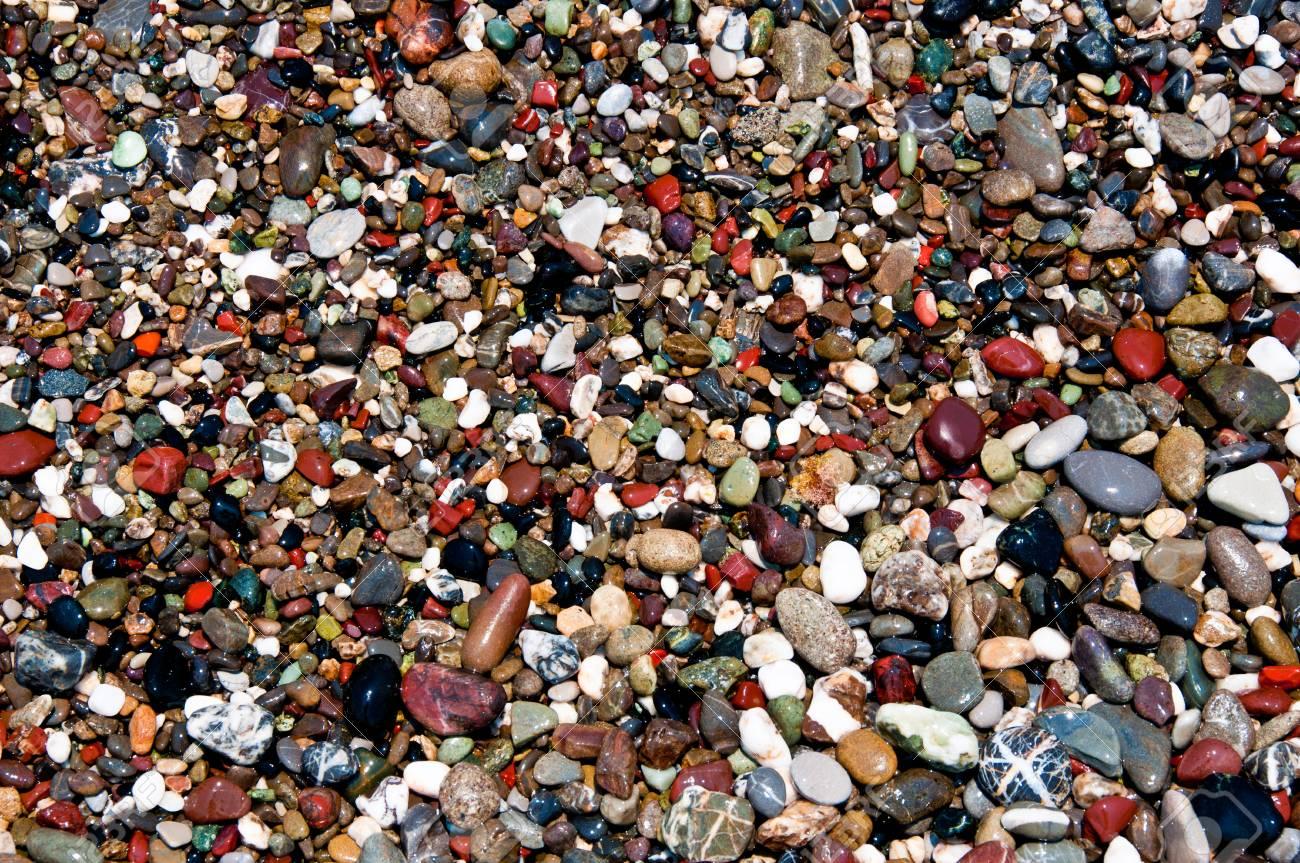 multicolor stone pebbles washed by sea water on an italian beach near Portofino - 43271175
