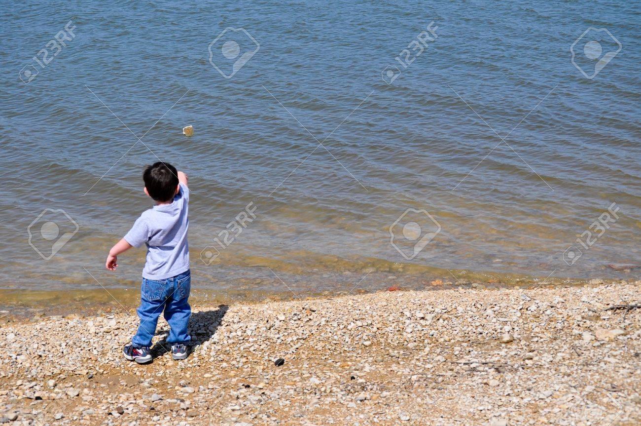 Boy Skipping Stone on Left - 7322046