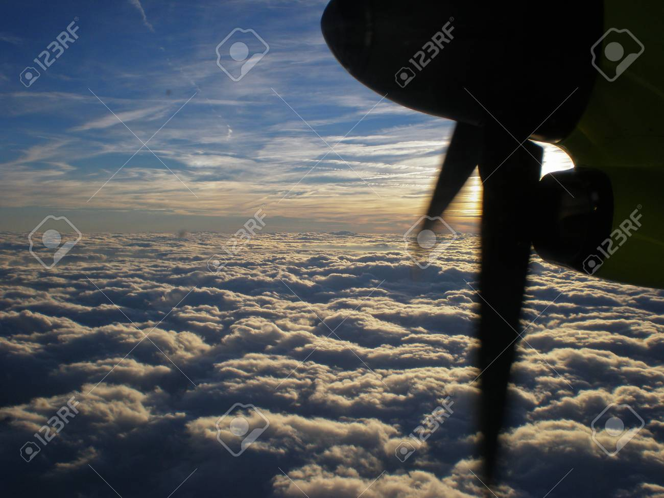 Looking Out Of A Airplane Window Above The Clouds Stock Photo